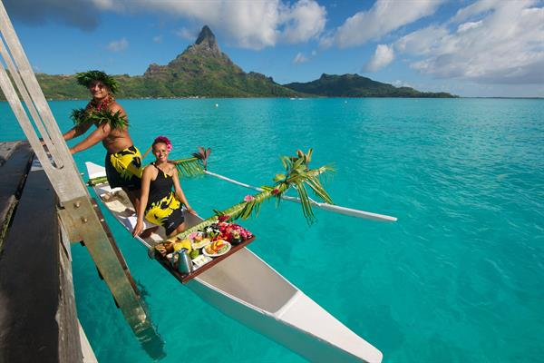 Romantic breakfast delivered by canoe