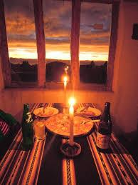 Candlelight dinner and drink on Lake Titicaca - Peru/Bolivia