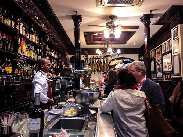 Tapas & a jug of sangria at local bar in Barcelona