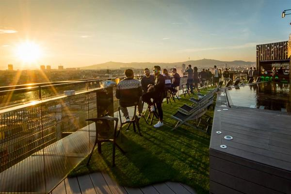 Sunset drinks at a rooftop bar in Barcelona