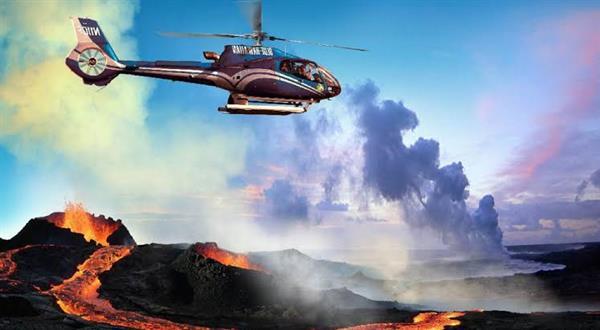 Helicopter flight over active volcanoes