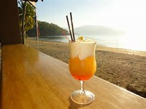 Beachfront dinner and cocktails for 2
